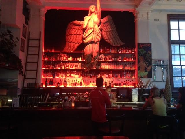 Angel sculpture hanging over the bar at Angel's Cut by Trustee